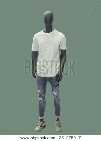 Full-length Man Mannequin Dressed In Summer Casual Clothes, Isolated On Green Background. No Brand N