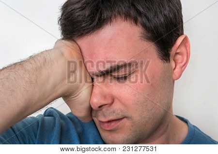 Man With Eyes Pain Is Holding His Aching Eye - Body Pain Concept