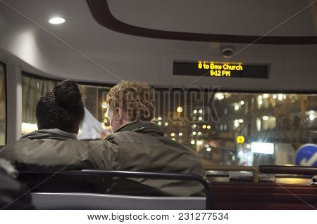 London - August 27, 2016: The Couple, Hugging, Sitting On The Bus In The Front Seat