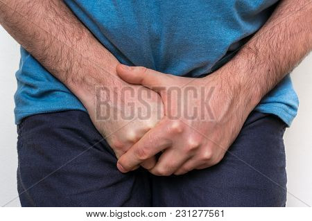 Man With Incontinence Problem Is Holding His Crotch - Incontinence Concept