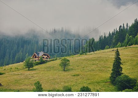 Mountain Landscape In The Fog. House In The Mountains. The Old Spooky House On The Land Of Nowhere.