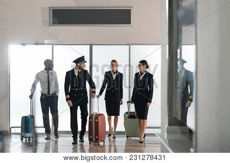 Aviation Personnel Team Walking By Airport Loggy