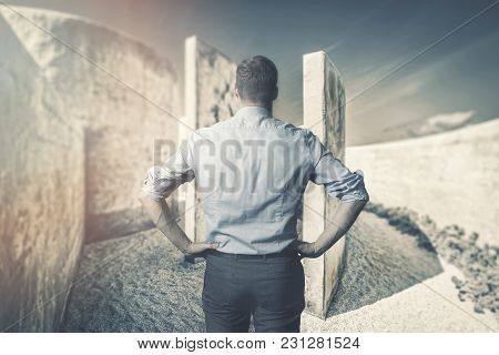 Business Difficulties And Challenges. Businessman In Front Of Labyrinth