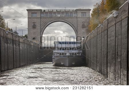 Uglich, Russia - July 19, 2016: Boat In Navigable Gateway Of Uglich Hydroelectric Power Station On R