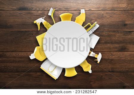 Image With Various Tools For Cleaning The Premises Of Yellow Color On A Wooden Background. The Conce