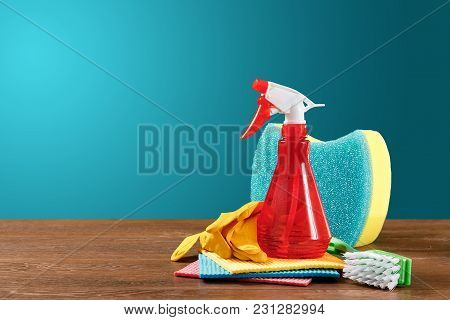 Image With Various Tools For Cleaning The Premises And Cleaning Agents On A Blue Background. The Con