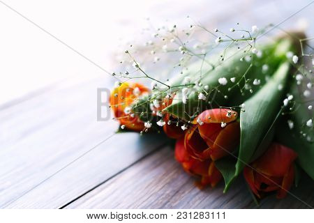 Blossoming Tulips On A Light Wooden Background. Spring Background, Concept.