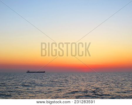 The View On Sunset At Sea, Ship On The Gorizont Line