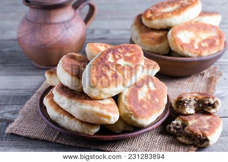 Patties With Potatoes And Meat On Wooden Table. Traditional Russian Food.
