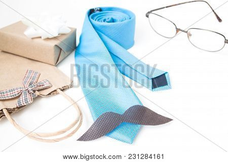 Happy Father's Day, Eyewears, Sign Of Mustache, Necktie And Gifts On White Background, Holiday Conce