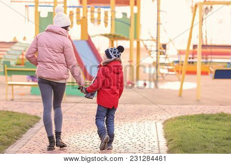 Woman with little boy outdoors. Child adoption