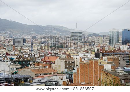 Roofs Of Barcelona. Piece Of The City Of Barcelona Seen From Above Shows Architecture Of A General A