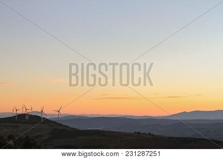 Natural Mountain Scenery With Windmills Generating Electricity