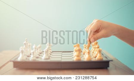 Kid Hold Chess Pieces In Chess Game Selective Focus Vintage Style For Education Or Business Concept.