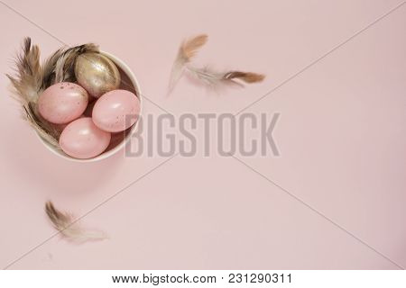 Pink And Gold Easter Eggs In A Bowl. Pastel Easter Concept With Eggs And Feathers. Punchy Pastels. C
