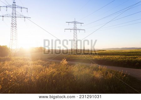 Electricity Pylons At Sunrise