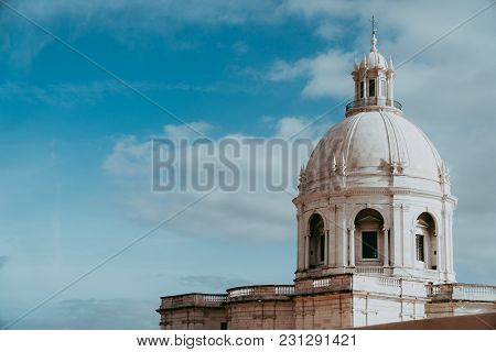 The White Cupola Of The National Pantheon In Lisbon With Blue Sky And Some Clouds In The Background.