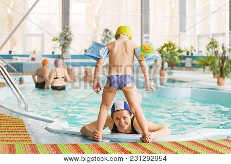 Grodno, Belarus - Health Resort Porechye. Mom And Children Are Bathing In A Shallow Pool.