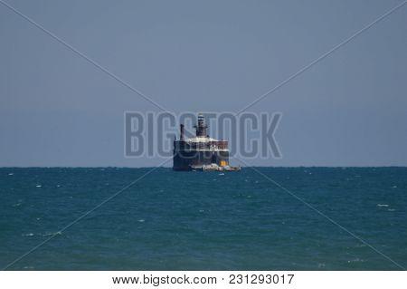 Wilson Avenue Water Intake Crib And Lighthouse In Lake Michigan On Horizon, Chicago