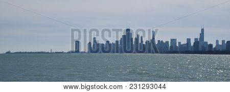 Chicago Skyline As Seen From Montrose Harbor, Including Pier Protruding Out Into Lake Michigan, High