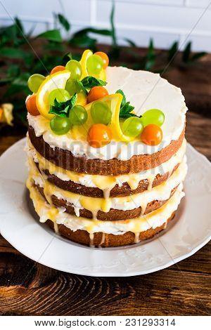 Layered Cake With Vanilla Mascarpone Cream Cheese, Lemon Curd Or Lemon Custard Decorated With Fresh