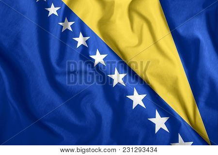 Bosnia And Herzegovina Flag Fluttering In The Wind. Colorful National Flag Of Bosnia And Herzegovina