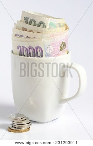 Czech Coins And  Banknotes Money Currency In White Cup Symbolizing Saving Money