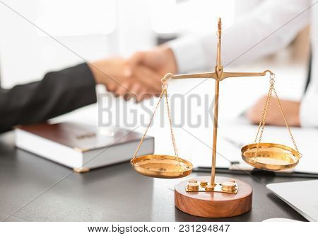 Scales of justice on table in lawyer's office