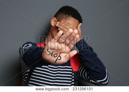 African-American boy with word