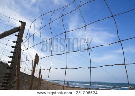 Rusty Wire Fence On The Beach, Selective Focus