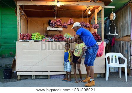 La Romana, Dominican Republic - 02 December 2017: Seller Of Of Fruit And Vegetables Which Arrived In