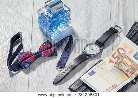 Man Perfume, Watch With A Black Leather Strap, Bow Tie And Black Leather Wallet With Euro Bills On G