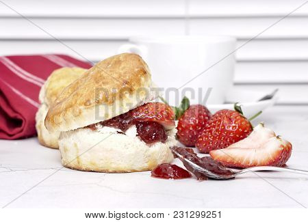 Cream Tea - Scones With Jam And Cream, Served With A Cup Of Tea On A White Background