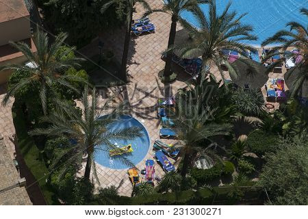 Benidorm, Spain - Sep 20, 2014: View Of Swimming Pool And Colorful Hotel Buildings On Sunny Summer D