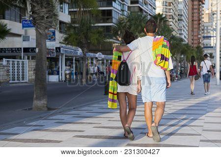 Benidorm, Spain - October 06, 2014: People Walking On The Shopping Street Of Mediterranean Resort Be