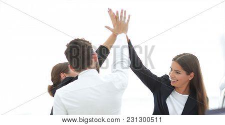 closeup.business team, giving each other a high five