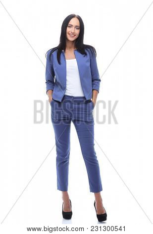 Confident young businesswoman standing with hands in pocket
