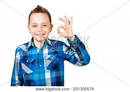 Portrait Of Young Teenager Laughing And Giving The Ok Sign.