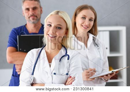 Beautiful Smiling Female Doctor Stand In Office Portrait. Physical And Patient Disease Prevention Ex