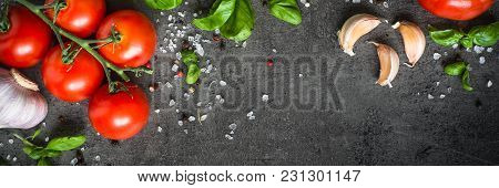 Food Cooking Background On Black Slate Table. Tomato, Spices Herbs. Ingredients For Cooking. Long Ba