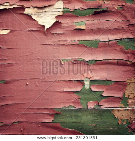 Pink Paint On The Green Surface. Dry Peeling Paint On The Wall. Text Frame For Text. Close Up Photo.