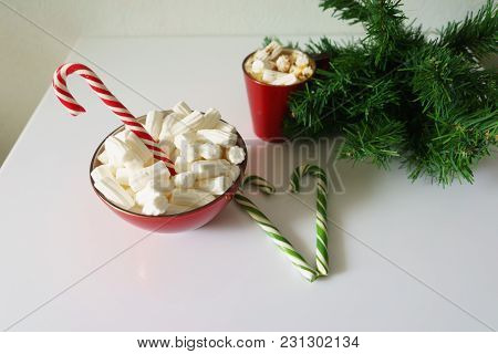 Christmas Background, Greeting Card With A Cup Of Coffee Or Hot Chocolate With Marshmallows, A Red P