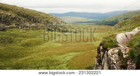 Green Hills And The Road On The Hillside. A Scenic View Of A Kerry Mountains And Surrounding Areas I