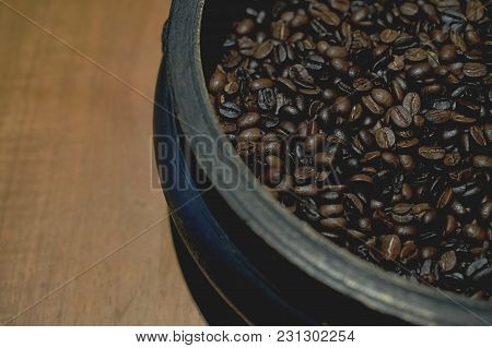 Coffee Beans Close Up On Wood Background