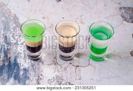 Set Of Strong Alcoholic Drink In Shot Glasses Shooters, Shots On Background Restaurant. Bar Alcoholi