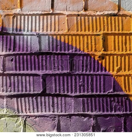 Abstract Detail Of Brick Wall With Fragment Of Colorful Graffiti. Urban Art Close-up, For Background