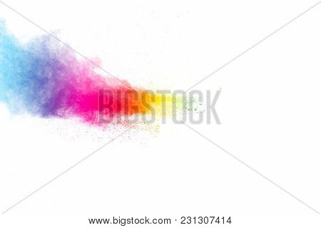 Abstract Multicolored Powder Splatter On White Background. Freeze Motion Of Color Powder Explosion O