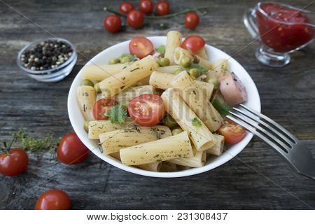Appetizing Pasta With Vegetables, Spices, Sausages, Green Peas And Sauce.