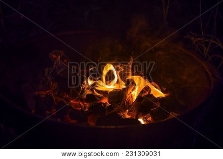 Fire Burning In A Barbecue, In A Hike Outside The City In The Forest
