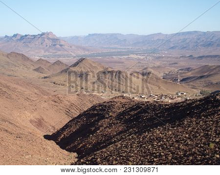 Rocky Atlas Mountains Range Landscapes In Southeastern Morocco Near Old Village Of Oulad And Clear B